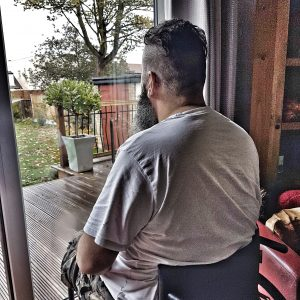 Wheelchair user Sat looking out window