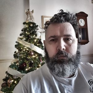 Bearded man, feeling unwell after Christmas. Spoonie